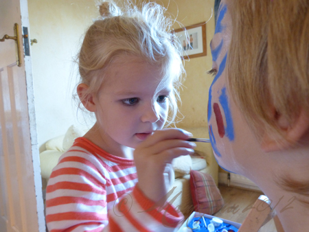 five year old facepainting brother